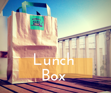 Lunch bag on wooden table